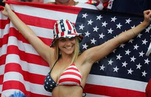 Girl at soccer game showing boobs and backwards flag