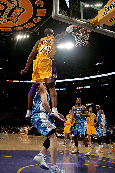 Kobe Bryant is towering above this metaphor