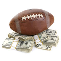 football on a pile of money